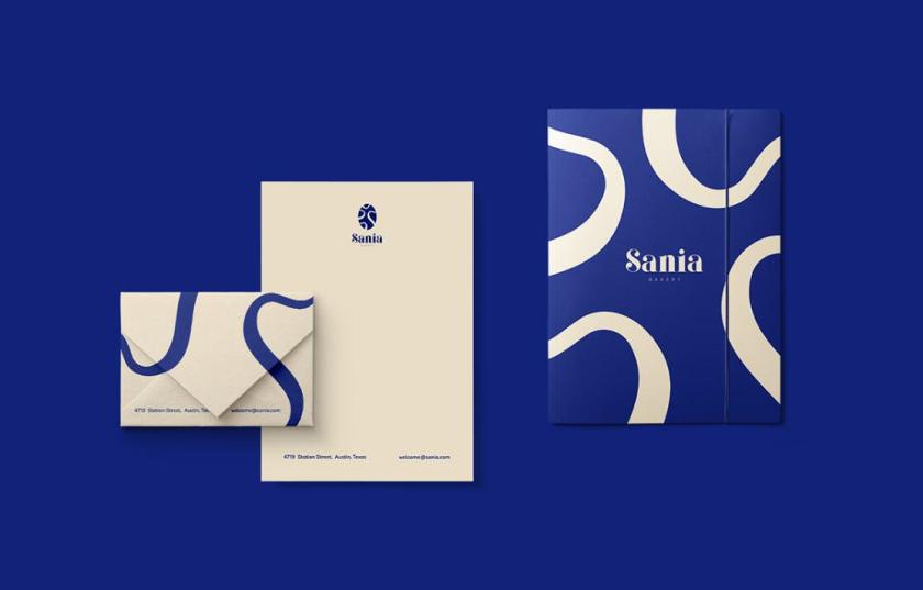 sania 烘培面包店品牌vi形象设计,宝蓝色面包手绘线条轮廓图案