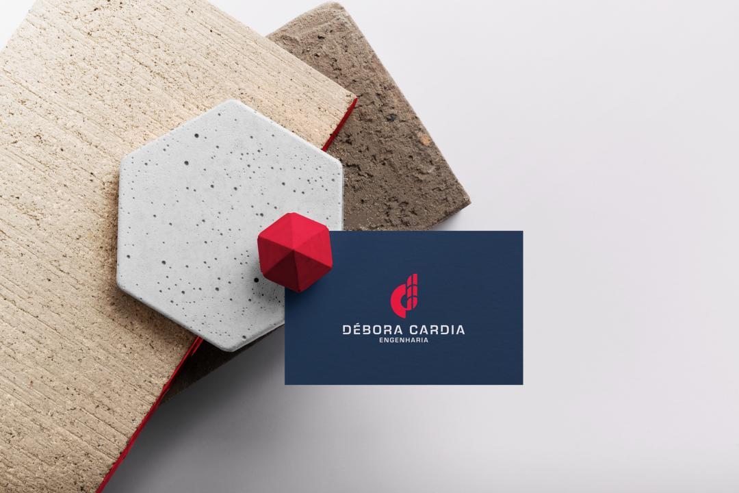 Débora Cardia 土木建筑公司品牌形象设计logo设计vi设计,字母dc+大楼图形